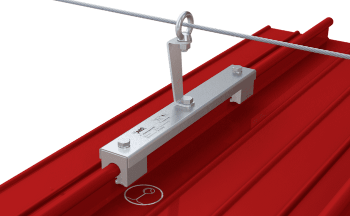 Image shows an intermediate bracket in a lifeline system installed on a metal roof without penetrating the surface