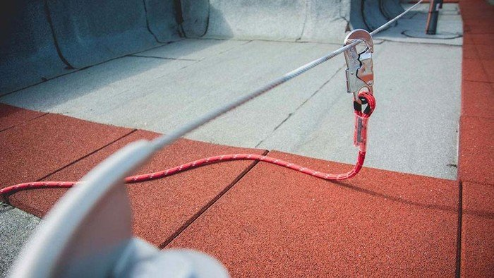 Photo showing the carabiner of an ABS Lanyard hooked up to a lifeline system