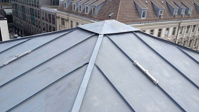 Photo showing this rounded-edge roof anchor device installed on a roof